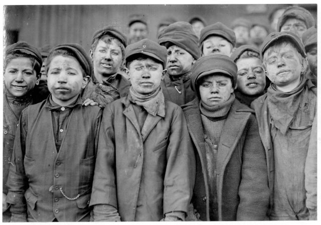 #  Title: Breaker boys in #9 Breaker, Hughestown Borough, Pa. Coal Co. Smallest boy is Angelo Ross, (See labels #1953 + #1951.) Location: Pittston, Pennsylvania. # Creator: Hine, Lewis Wickes, 1874-1940 photographer # Date Created/Published: 1911 January. # Medium: 1 photographic print. # Part of: Photographs from the records of the National Child Labor Committee (U.S.) # Reproduction Number: LC-DIG-nclc-01139 (color digital file from b&w original print) LC-USZ62-23757 (b&w film copy negative) # Rights Advisory: No known restrictions on publication. # Call Number: LOT 7477, no. 1950 [P&P] # Repository: Library of Congress Prints and Photographs Division Washington, D.C. 20540 USA